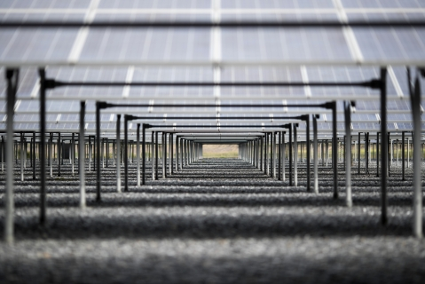Solar panels stand at a solar farm in Nakhon Nayok, Thailand. (Photographer: Brent Lewin/Bloomberg)