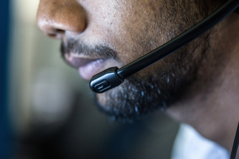 An employee wears a headset while working at the Avise Techno Solutions LLP call center in Kolkata. (Photograph: Taylor Weidman/Bloomberg)