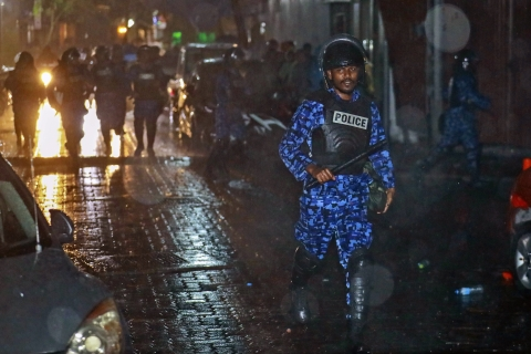 A Maldives policeman charges with baton towards protesters after the government declared a 15-day state of emergency in Male, Maldives, early on February 6, 2018. (Photograph: AP/PTI)