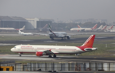 An Air India Ltd. aircraft awaits its turn to take off at Mumbai International Airport in Mumbai. (Photographer: Adeel Halim/Bloomberg)