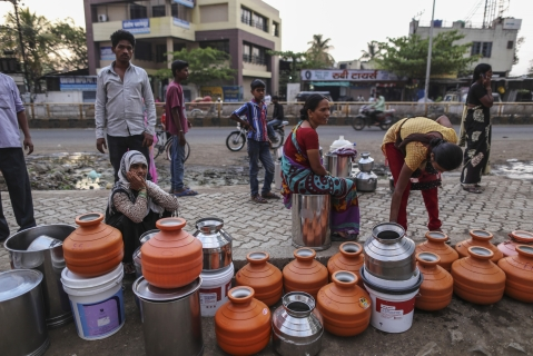 Water commuters wait in line to fill containers at the Vivekananda Chowk water tank in Latur, Maharashtra, India. (Photographer: Dhiraj Singh/Bloomberg)