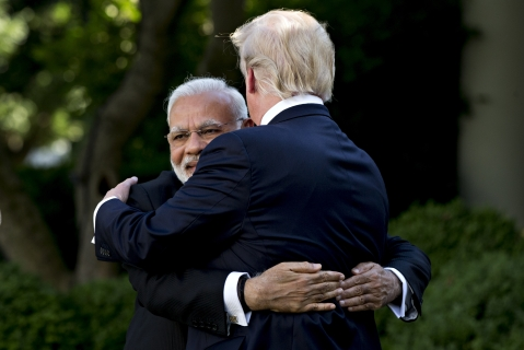 Narendra Modi, India's prime minister, left, hugs U.S. President Donald Trump during a joint statement in the White House in Washington, D.C., U.S., on June 26, 2017. (Photographer: Andrew Harrer/Bloomberg)