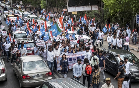 NSUI and DUSU activists display placards and shout slogans during a protest march against rape cases, atrocities against women and various other issues,  in North Campus, Delhi University on Friday. (Source: PTI)