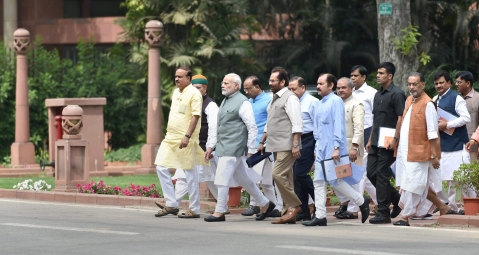 Prime Minister Narendra Modi along with Parliamentary Affairs Minister Ananth Kumar, Mukhtar Abbas Naqvi and other MPs leave after the BJP Parliamentary Party Meeting at the Parliament Library Building in New Delhi on April 6, 2018. (Photograph: PTI)
