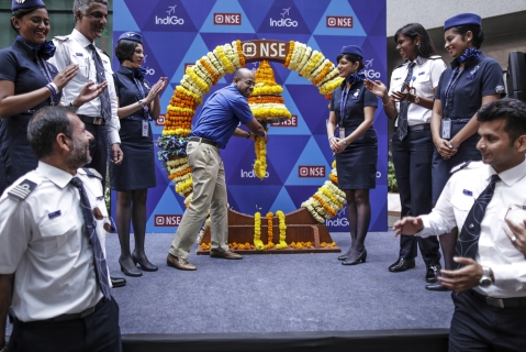 Aditya Ghosh rings a bell during the listing ceremony of the airline at the National Stock Exchange in Mumbai,  on  Nov. 10, 2015. (Photographer: Dhiraj Singh/Bloomberg)