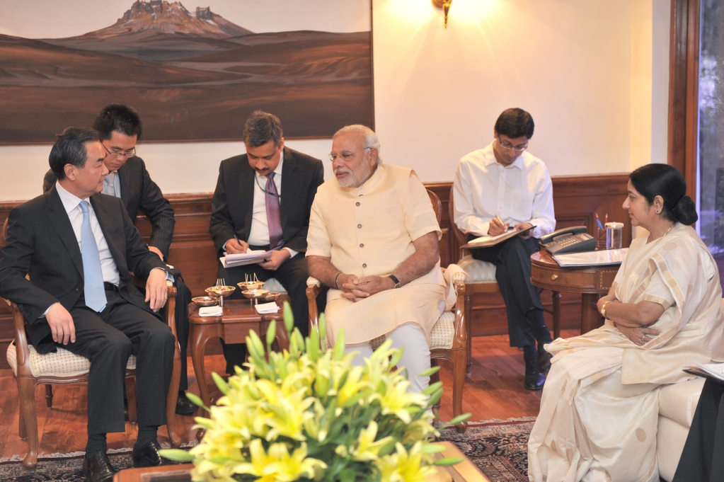 Minister of Foreign Affairs of the People's Republic of China Wang Yi meets Prime Minister  Narendra Modi and Minister for External Affairs Sushma Swaraj in New Delhi, on June 9, 2014. (Photograph: PIB)