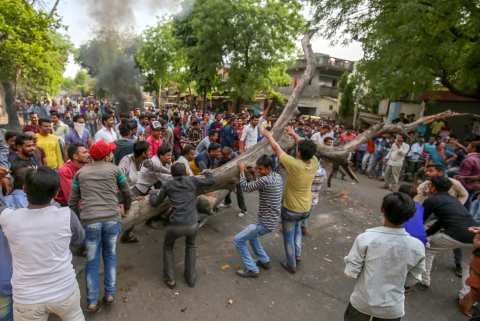 Members of the Dalit community block a road with a tree as they stage a protest during 'Bharat Bandh' against the alleged 'dilution' of Scheduled Castes/Scheduled Tribes act, in Ahmedabad on April 2, 2018. (Photograph: PTI)