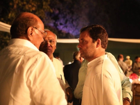 "Congress President Rahul Gandhi speaks to NCP President Sharad Pawar at a dinner gathering of opposition parties, on March 13, 2018. (Photograph: <a href=""https://twitter.com/INCIndia"">@<b>INCIndia</b></a>)"