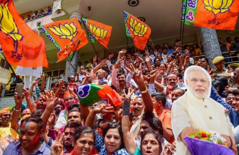 BJP workers celebrate the party's lead in  Karnataka Assembly Election 2018  outside the party office in Bengaluru on Tuesday. (Photographer: Shailendra Bhojak/PTI)