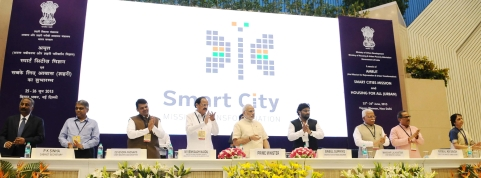 "Prime Minister Narendra Modi at the launch of the Smart Cities Mission, in New Delhi on June 25, 2015. (Photograph: PIB)<a href=""https://www.facebook.com/sharer/sharer.php?u=http://pibphoto.nic.in/photo//2015/Jun/l2015062566979.jpg""><i><br></i></a>"