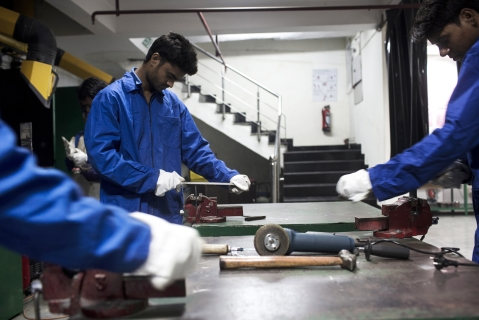 Students file metal during a welding class during vocational training at the Infrastructure Leasing & Financial Services  Institute of Skills in New Delhi, India. (Photograph: Udit Kulshrestha/Bloomberg)