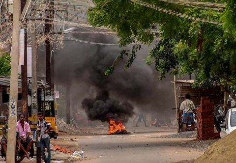 Burning tyres are seen placed to block a road during a protest demanding the closure of Vedantas Sterlite Copper unit, in Tuticorin. (Source: PTI)