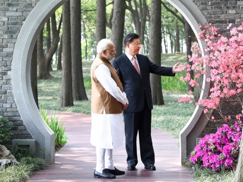 Prime Minister Narendra Modi, left, and Chinese President Xi Jinping talk at a garden in Wuhan in central China's Hubei Province, on April 28, 2018. (Photograph: Xinhua/AP/PTI)