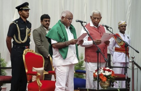 Karnataka Governor Vajubhai Vala administers oath to Bharatiya Janata Party (BJP) leader B S Yeddyurappa as Chief Minister of the state at a ceremony in Bengaluru. (Source: PTI)