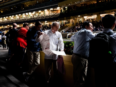 The Hong Kong Jockey Club now offers individual gamblers tools to help them mimic the betting patterns of the syndicates. (Photographer: Xyza Bacani/ Redux For Bloomberg Businessweek)