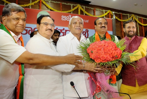 Union ministers and BJP leaders Prakash Javadekar, Ananth Kumar and JP Nadda greet Karnataka unit chief of the party B S Yeddyurappa, after he was elected leader of the BJP legislature party, in Bengaluru. (Source PTI)