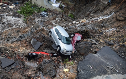 Several cars struck in debris after a wall collapsed at a construction site in Antop Hill, Wadala East area, in Mumbai. (Source: PTI)