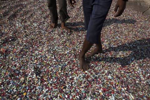 Recovered plastics are laid out to dry on a rooftop in a slum area of India. (Photographer: Brent Lewin/Bloomberg)