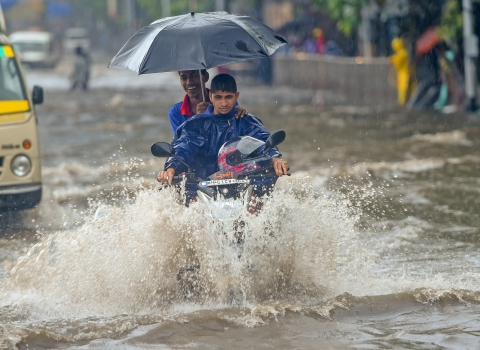 A motorcyclist wades through a water-logged street at Kings Circle after heavy rains in Mumbai on Saturday, June 09, 2018. (Source: PTI)
