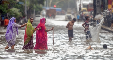 People cross the water-logged street at Kings Circle after heavy rains in Mumbai on Saturday, June 09, 2018. (Source: PTI)
