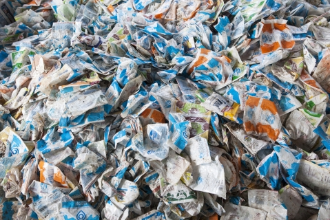 Arranged household waste sits in a warehouse (Photographer: Samyukta Lakshmi/Bloomberg)