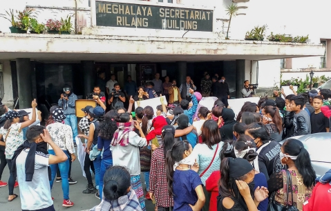 People from different parts of the city stage a protest Meghalaya Secretariat during curfew, in Shillong on Monday. (Source: PTI)