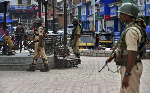 Security personnel stand guard at Lal Chowk in Srinagar, on Tuesday 19, 2018. BJP today decided to pull out of its ruling alliance with Peoples Democratic Party (PDP) in Jammu and Kashmir. (Photographer: S Irfan/PTI)