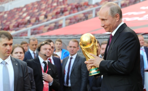 "A photo of Vladimir Putin holding the World Cup trophy at the Luzhniki Stadium in Moscow released by the Kremlin. (Source: <a href=""http://ww.kremlin.ru"">Kremlin Website</a>)"