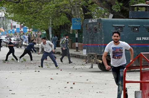 Students targeting a police vehicle during clashes outside a college in the vicinity of Lal Chowk in Srinagar on April 24, 2017. (Photographer: S Irfan/PTI)