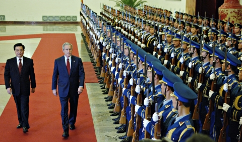 U.S. President George W. Bush reviews an honor guard with Chinese President Hu Jintao, at the Great Hall of the People in Beijing, China, November 20, 2005. (Photographer: Daniel Acker/Bloomberg News)