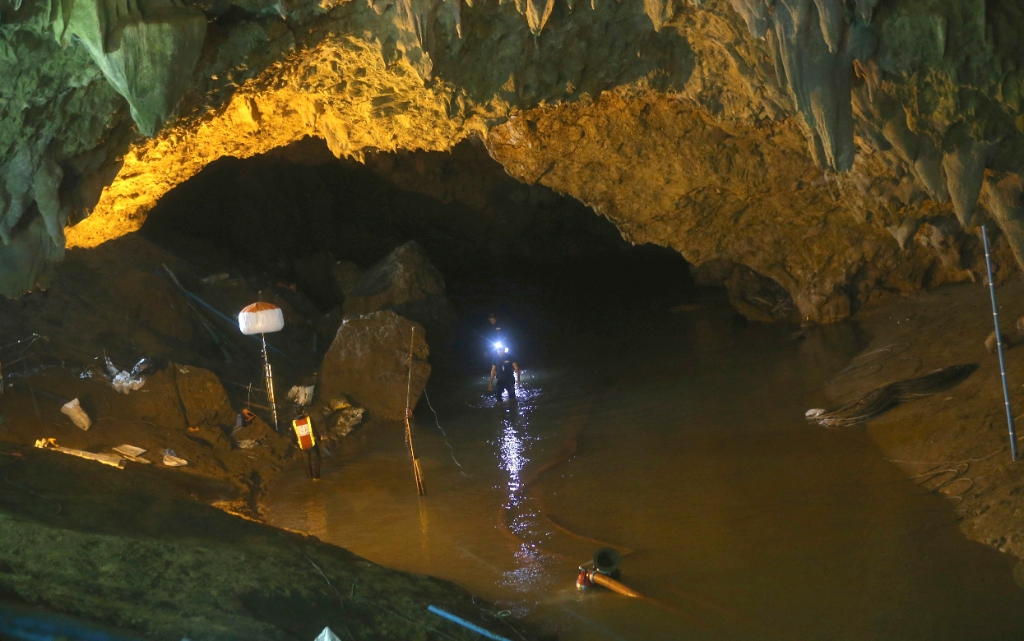 Rescuers walk out of the entrance to a cave complex where 12 soccer team members and their coach went missing, in Mae Sai, Chiang Rai province, in northern Thailand (Source: PTI)