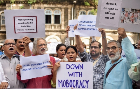 Documentary filmmaker Anand Patwardhan with other activists raise slogans to condemn mob lynching, in Mumbai on  July 19, 2018. (Photographer: Shashank Parade/PTI)