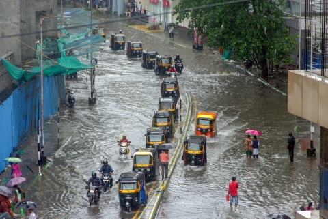 Autorickshaws wade through a waterlogged road during heavy rains, in Thane (Source: PTI)
