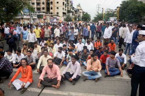 Maratha community people stop the traffic during their Maratha Kranti Morcha Rasta Roko protest demanding reservation, in Thane, Mumbai on Wednesday, July 25, 2018. (Source: PTI)