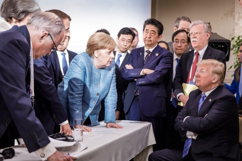 U.S. President Donald Trump with German Chancellor Angela Merkel, French President Emmanuel Macron and British Prime Minister Theresa May, as Japanese Prime Minister Shinzo Abe, and U.S. NSA John Bolton look on, at the G7 Summit in Quebec, Canada, on June 9, 2018. (Photograph: German Federal Press Office/Twitter)