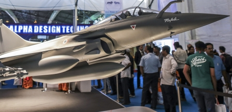 A model of Rafale multirole fighter aircraft, manufactured by Dassault Aviation SA., stands on display during the Aero India 2015 air show at Air Force Station Yelahanka, in Bengaluru, India. (Photographer: Dhiraj Singh/Bloomberg)