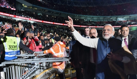 Prime Minister Narendra Modi waves as he leaves Wembley Stadium in London after addressing the Indian community on Friday night. (PTI Photo by Vijay Verma)