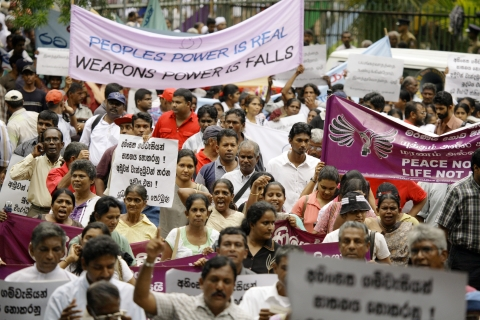 People participate in a peace rally organized by the National Anti War Front, in, Colombo, Sri Lanka on August 17, 2006. (Photographer: Sebastian Posingis/Bloomberg News)