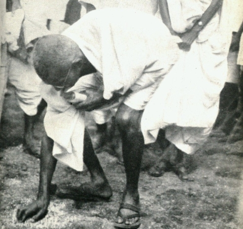 "Mahatma Gandhi picks up salt after the march to Dandi, Gujarat, on April 6, 1930. (Photograph: <a href=""https://twitter.com/narendramodi"">@<b>narendramodi</b></a>/Twitter)"