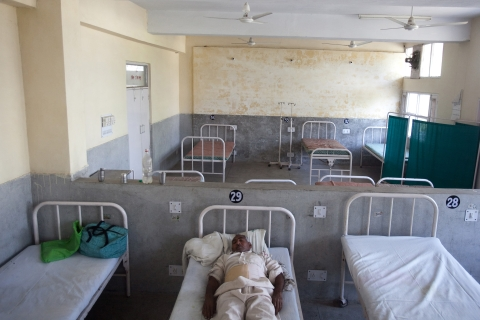 A lone patient sleeps in the post operation recovery ward of the district hospital in Jind, Haryana, India. (Photographer: Prashanth Vishwanathan/Bloomberg)