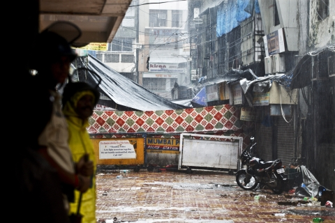 Police officers stand guard near the site of a bomb explosion in the area of Zaveri Bazaar in Mumbai, India, on  July 14, 2011. (Photographer: Kainaz Amaria/Bloomberg)