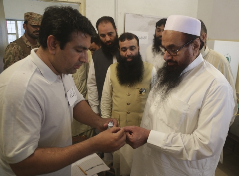 Lashkar-e-Taiba chief Hafiz Saeed votes in the general election in Pakistan, on July 25, 2018. (Photograph: AP/PTI)