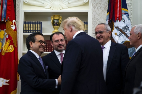 U.S. President Donald Trump  greets Mexican diplomats after announcing that the U.S. and Mexico reached a trade deal, in the Oval Office of the White House in Washington, D.C. on Aug. 27, 2018. (Photographer: Al Drago/Bloomberg)