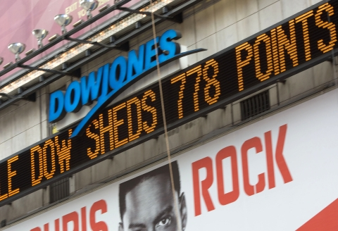 The Dow Jones ticker in Times Square as U.S. stocks plunged the most since the 1987 crash, in New York,  on  Sept. 29, 2008. (Photographer: Jin Lee/Bloomberg News)