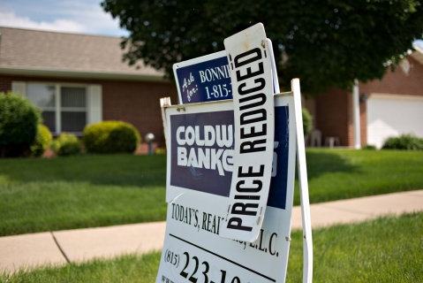 A  sign stands outside a home for sale in Peru, Illinois, U.S. (Photographer: Daniel Acker/Bloomberg)