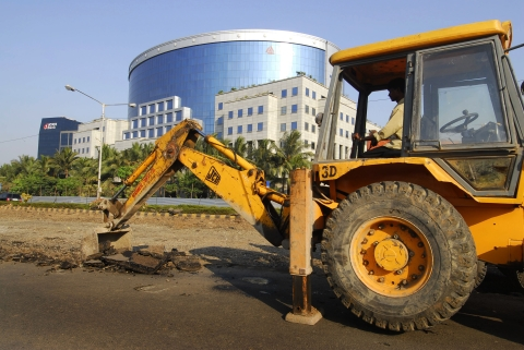Road construction takes place near the IL&FS building, in Mumbai, India. (Photographer: Abhijit Bhatlekar/Bloomberg News)