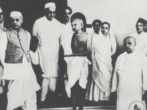 Mahatma Gandhi with Jawaharlal Nehru on his right, and Vallabhbhai Patel on his left. (Photograph: Nehru Memorial Museum and Library)