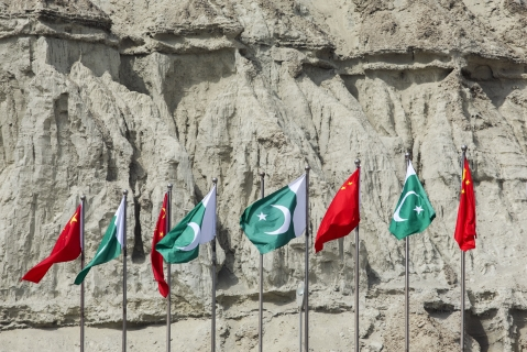 Chinese national flags fly next to Pakistani national flags at the Gwadar port in Balochistan, Pakistan. (Photographer: Asim Hafeez/Bloomberg)