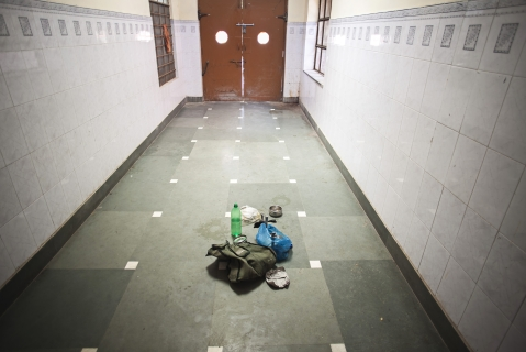 Personal belongings of a patient's relative sit in a corridor at a hospital in Bikaner, Rajasthan. (Photographer: Prashanth Vishwanathan/Bloomberg)