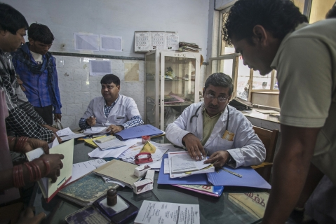 Doctors talk to patients as they look at their medical records in Bikaner, Rajasthan. (Photographer: Prashanth Vishwanathan/Bloomberg)
